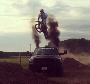 Dillon jumping his dirt bike over a truck!